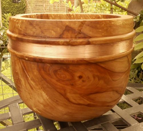 Apple-wood deep bowl, green-turned and with copper banding.