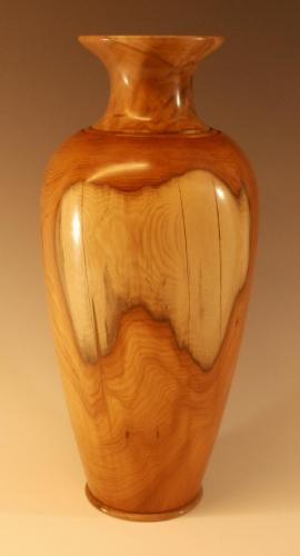 Tall vase in yew, with spalted beech neck.